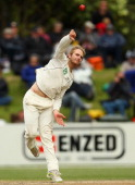 Kane Williamson of New Zealand bowls during day four of the First Test match between New Zealand and South Africa at University Oval on March 10 2012...