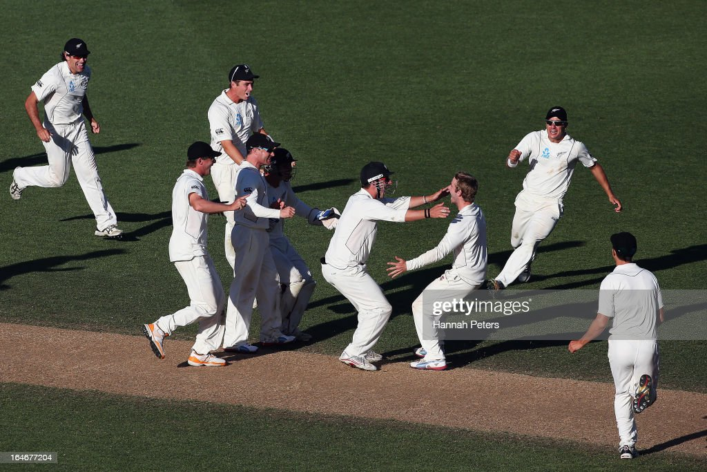 <a gi-track='captionPersonalityLinkClicked' href=/galleries/search?phrase=Kane+Williamson&family=editorial&specificpeople=4738503 ng-click='$event.stopPropagation()'>Kane Williamson</a> of New Zealand celebrates the wicket of James Anderson of England during day five of the Third Test match between New Zealand and England at Eden Park on March 26, 2013 in Auckland, New Zealand.
