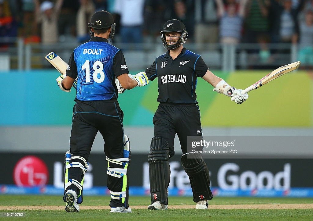 <a gi-track='captionPersonalityLinkClicked' href=/galleries/search?phrase=Kane+Williamson&family=editorial&specificpeople=4738503 ng-click='$event.stopPropagation()'>Kane Williamson</a> of New Zealand celebrates with team mate <a gi-track='captionPersonalityLinkClicked' href=/galleries/search?phrase=Trent+Boult&family=editorial&specificpeople=4880813 ng-click='$event.stopPropagation()'>Trent Boult</a> after hitting the winning six runs during the 2015 ICC Cricket World Cup match between Australia and New Zealand at Eden Park on February 28, 2015 in Auckland, New Zealand.