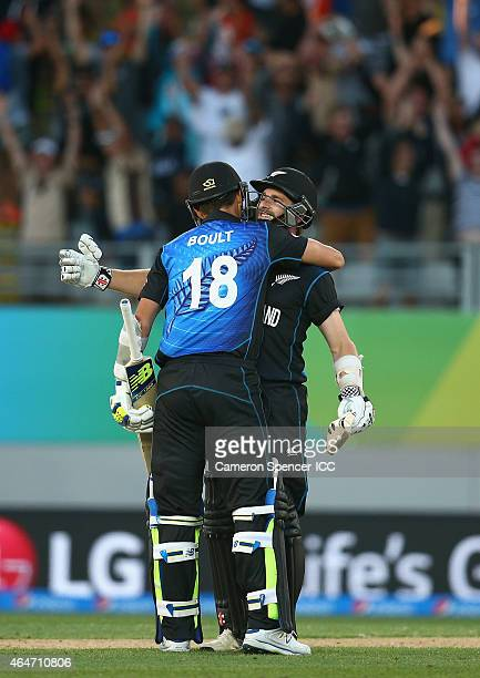 Kane Williamson of New Zealand celebrates with team mate Trent Boult after hitting the winning six runs during the 2015 ICC Cricket World Cup match...