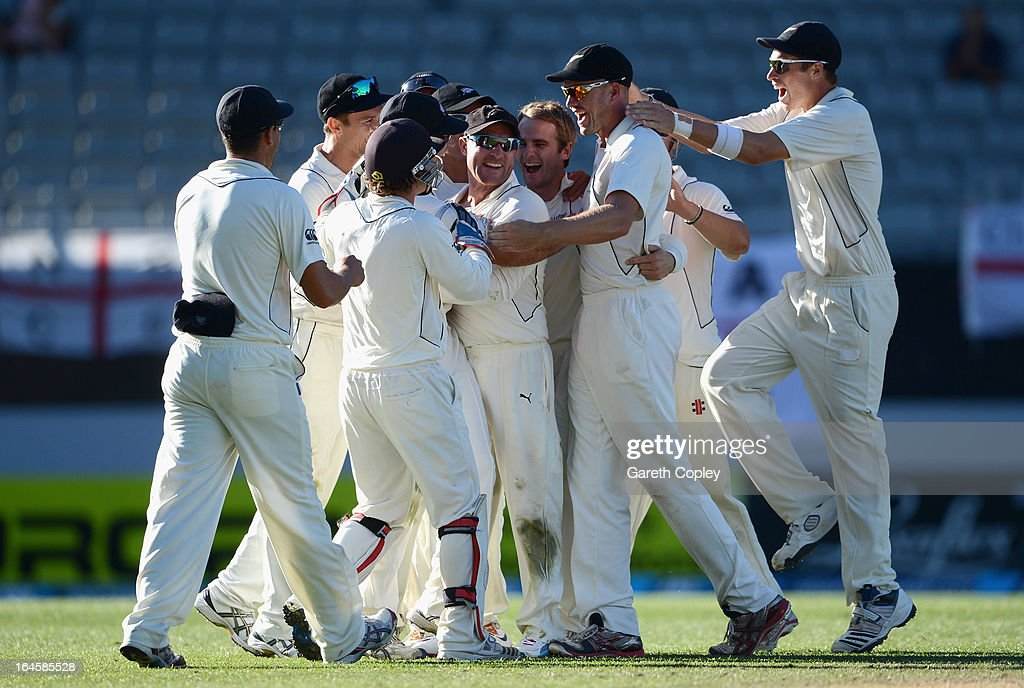 <a gi-track='captionPersonalityLinkClicked' href=/galleries/search?phrase=Kane+Williamson&family=editorial&specificpeople=4738503 ng-click='$event.stopPropagation()'>Kane Williamson</a> of New Zealand celebrates with teammates after dismissing England captain Alastair Cook during day four of the Third Test match between New Zealand and England at Eden Park on March 25, 2013 in Auckland, New Zealand.