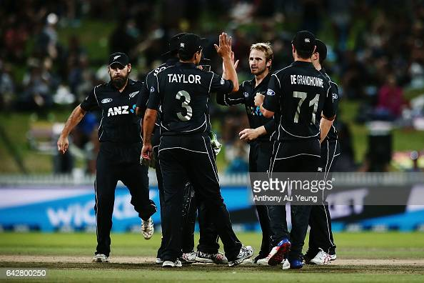 Kane Williamson of New Zealand celebrates with teammates for the wicket of Hashim Amla of South Africa during the First One Day International match...