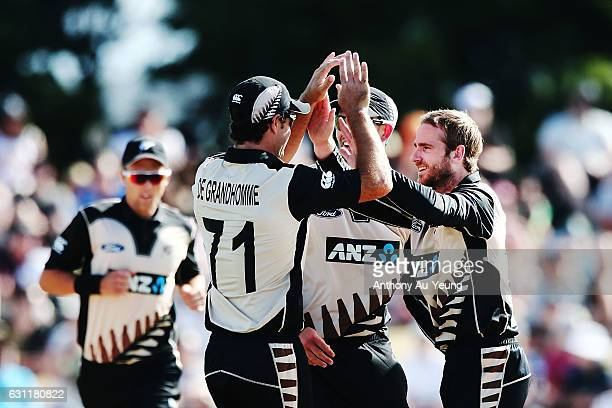 Kane Williamson of New Zealand celebrates with the team for his wicket of Sabbir Rahman of Bangladesh during the third Twenty20 International match...