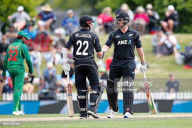 Kane Williamson of New Zealand congratulates team mate Neil Broom of after reaching a half century during the third One Day International match...