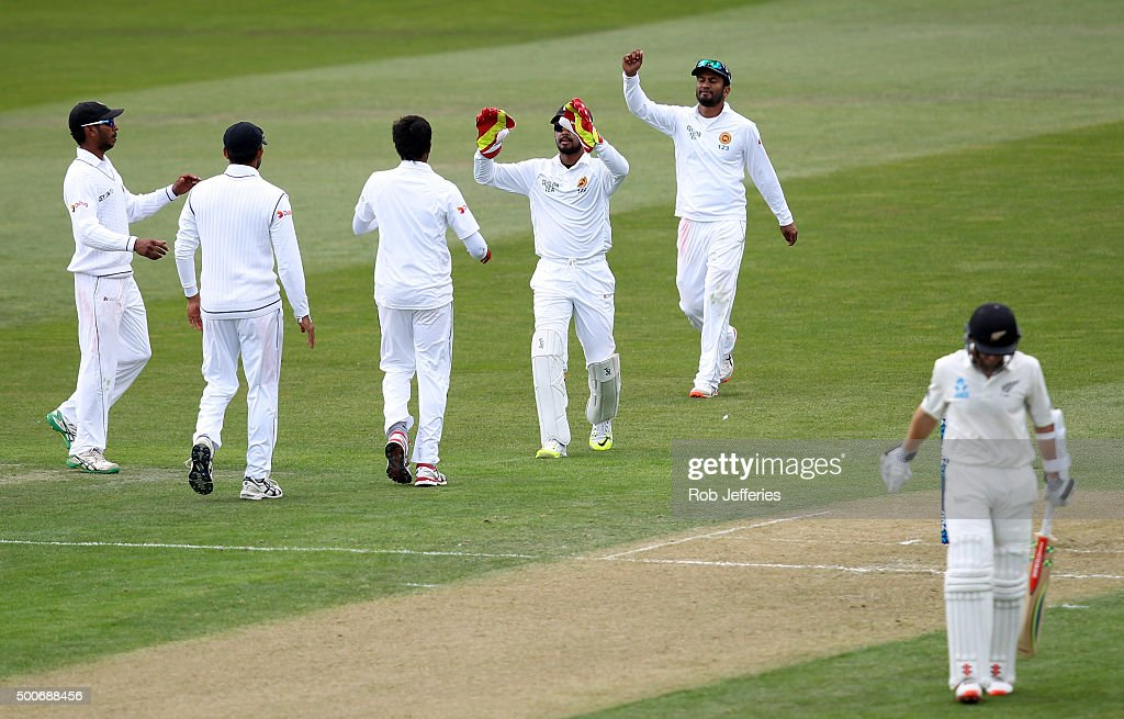<a gi-track='captionPersonalityLinkClicked' href=/galleries/search?phrase=Kane+Williamson&family=editorial&specificpeople=4738503 ng-click='$event.stopPropagation()'>Kane Williamson</a> of New Zealand departs after being dismissed caught behind by <a gi-track='captionPersonalityLinkClicked' href=/galleries/search?phrase=Dimuth+Karunaratne&family=editorial&specificpeople=7915648 ng-click='$event.stopPropagation()'>Dimuth Karunaratne</a> of Sri Lanka off the bowling of Nuwan Pradeep during day one of the First Test match between New Zealand and Sri Lanka at University Oval on December 10, 2015 in Dunedin, New Zealand.