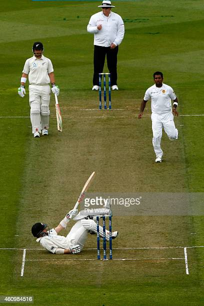 Kane Williamson of New Zealand falls over during day one of the Second Test match between New Zealand and Sri Lanka at Basin Reserve on January 3...