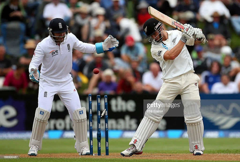 <a gi-track='captionPersonalityLinkClicked' href=/galleries/search?phrase=Kane+Williamson&family=editorial&specificpeople=4738503 ng-click='$event.stopPropagation()'>Kane Williamson</a> of New Zealand is bowled by Monty Panesar of England as <a gi-track='captionPersonalityLinkClicked' href=/galleries/search?phrase=Matt+Prior+-+Cricket+Player&family=editorial&specificpeople=13652111 ng-click='$event.stopPropagation()'>Matt Prior</a> looks on during day three of the First Test match between New Zealand and England at University Oval on March 8, 2013 in Dunedin, New Zealand.