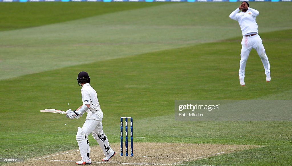 <a gi-track='captionPersonalityLinkClicked' href=/galleries/search?phrase=Kane+Williamson&family=editorial&specificpeople=4738503 ng-click='$event.stopPropagation()'>Kane Williamson</a> of New Zealand is caught behind by <a gi-track='captionPersonalityLinkClicked' href=/galleries/search?phrase=Dimuth+Karunaratne&family=editorial&specificpeople=7915648 ng-click='$event.stopPropagation()'>Dimuth Karunaratne</a>of Sri Lanka off the bowling of Nuwan Pradeep during day one of the First Test match between New Zealand and Sri Lanka at University Oval on December 10, 2015 in Dunedin, New Zealand.