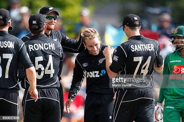Kane Williamson of New Zealand is congratulated by team mates after the wicket of Tanveer Haider of Bangladesh during the second One Day...