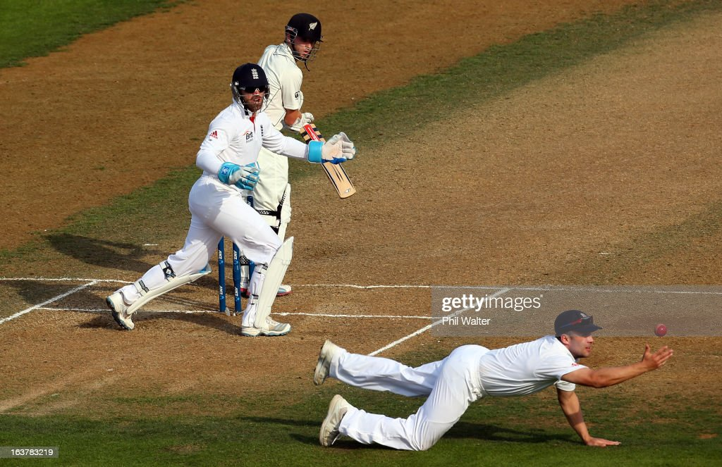 <a gi-track='captionPersonalityLinkClicked' href=/galleries/search?phrase=Kane+Williamson&family=editorial&specificpeople=4738503 ng-click='$event.stopPropagation()'>Kane Williamson</a> of New Zealand manages to get the ball past <a gi-track='captionPersonalityLinkClicked' href=/galleries/search?phrase=Jonathan+Trott&family=editorial&specificpeople=654505 ng-click='$event.stopPropagation()'>Jonathan Trott</a> of England during day three of the second Test match between New Zealand and England at Basin Reserve on March 16, 2013 in Wellington, New Zealand.