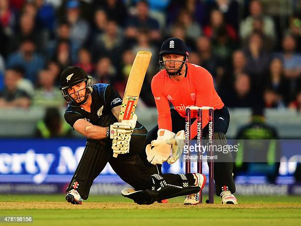 Kane Williamson of New Zealand plays a shot as England wicketkeeper Jonny Bairstow looks on during the NatWest International Twenty20 match between...