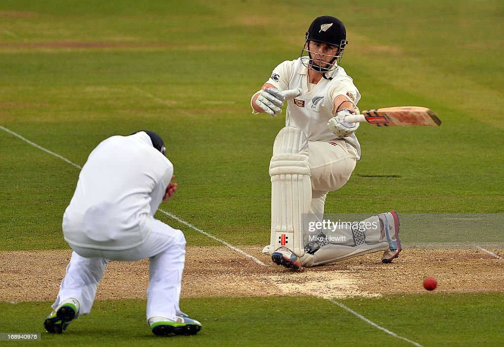 <a gi-track='captionPersonalityLinkClicked' href=/galleries/search?phrase=Kane+Williamson&family=editorial&specificpeople=4738503 ng-click='$event.stopPropagation()'>Kane Williamson</a> of New Zealand plays one handed as <a gi-track='captionPersonalityLinkClicked' href=/galleries/search?phrase=Joe+Root&family=editorial&specificpeople=6688996 ng-click='$event.stopPropagation()'>Joe Root</a> of England takes cover at short leg during day two of 1st Investec Test match between England and New Zealand at Lord's Cricket Ground on May 17, 2013 in London, England.