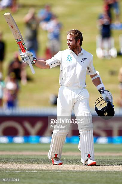 Kane Williamson of New Zealand raises his bat as he makes a century during day four of the Second Test match between New Zealand and Sri Lanka at...