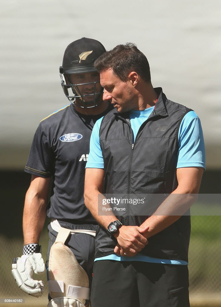 Kane Williamson of New Zealand speaks with Umpire Richard Kettleborough during a New Zealand nets session at Basin Reserve on February 11, 2016 in Wellington, New Zealand.