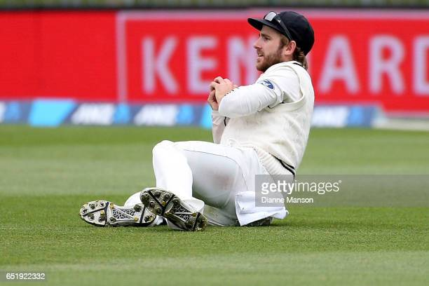 Kane Williamson of New Zealand takes the catch to dismiss Dean Elgar of South Africa during day four of the First Test match between New Zealand and...