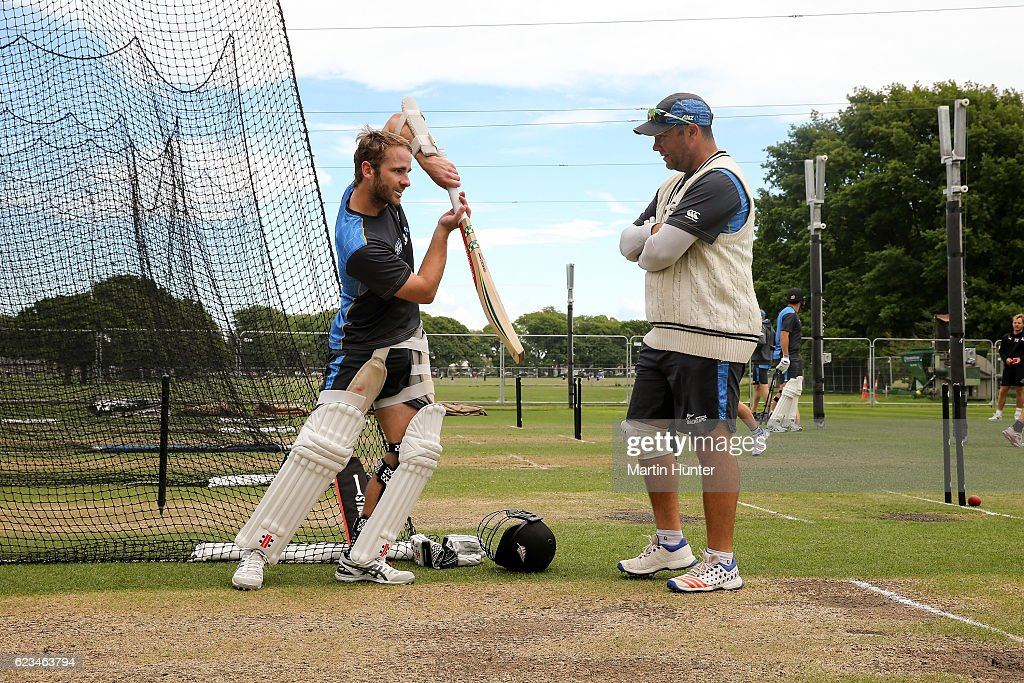 Kane Williamson (L) of New Zealand talks with batting coach Craig McMillan (R) during a New Zealand nets session at Hagley Oval on November 16, 2016 in Christchurch, New Zealand.