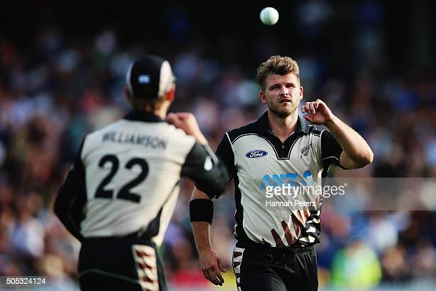 Kane Williamson of the Black Caps throws the ball to Corey Anderson of the Black Caps during the International Twenty20 match between New Zealand and...