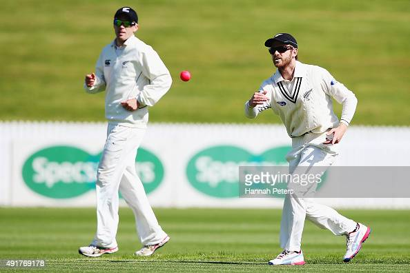 Kane Williamson throws the new pink cricket ball during a New Zealand cricket training session at Seddon Park on October 8 2015 in Hamilton New...
