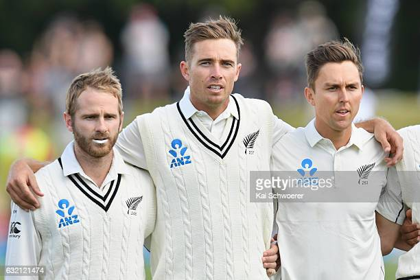 Kane Williamson Tim Southee and Trent Boult of New Zealand line up for their national anthem during day one of the Second Test match between New...