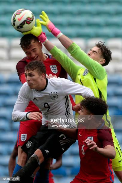 Kane Wilson Thomas McGill and Joel Latibeaudiere of England U17 challenge JannFiete Arp of Germany U17 during the U17 Algarve Cup Tournament Match...