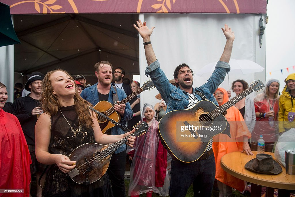 Kanene Donehey Pipkin, Brian Elmquist and Zach Williams of The Lone Bellow perform in the crowd when their set was cancelled due to severe weather at Fair Grounds Race Course on April 30, 2016 in New Orleans, Louisiana.