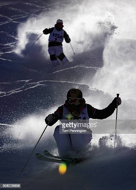 Kang Chen of china and Philippe Marquis of Canada take a practice run for the men's moguls for the 2016 FIS Freestyle Ski World Cup at Deer Valley...