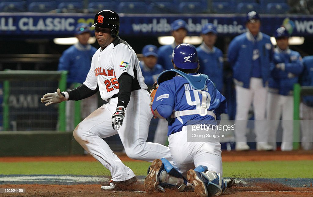 Kang Min-Ho of South Korea tags out Andruw Jones of Netherlands as he slides into home in the fourth inning during the World Baseball Classic First Round Group B match between South Korea and the Netherland at Intercontinental Baseball Stadium on March 2, 2013 in Taichung, Taiwan.