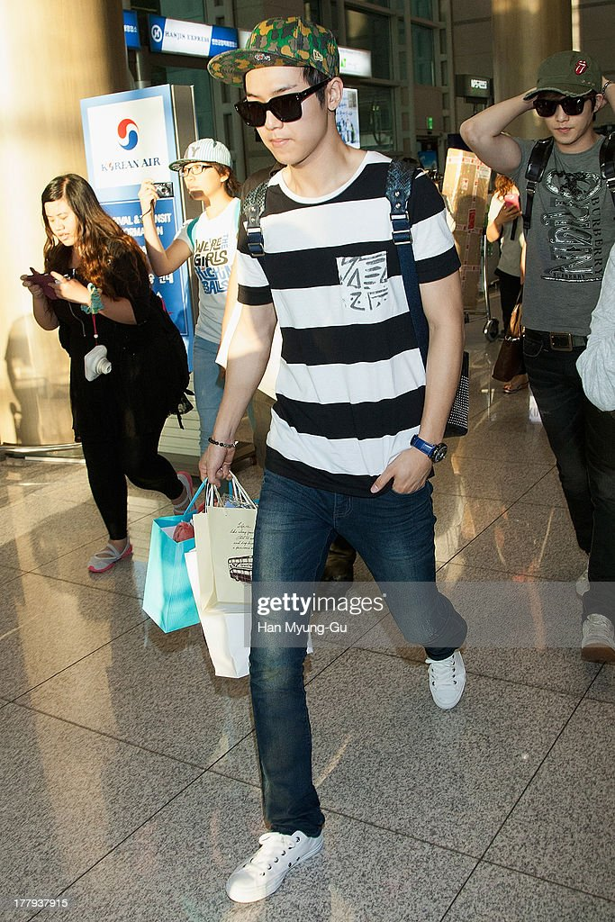 Kang Min-Hyuk of South Korean boy band CNBLUE is seen upon arrival at the Incheon International Airport on August 26, 2013 in Incheon, South Korea.
