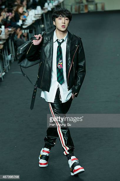 Kang SeungYoon of South Korean boy band WINNER showcases designs on the runway during the Beyond Closet show as part of Seoul Fashion Week S/S 2015...