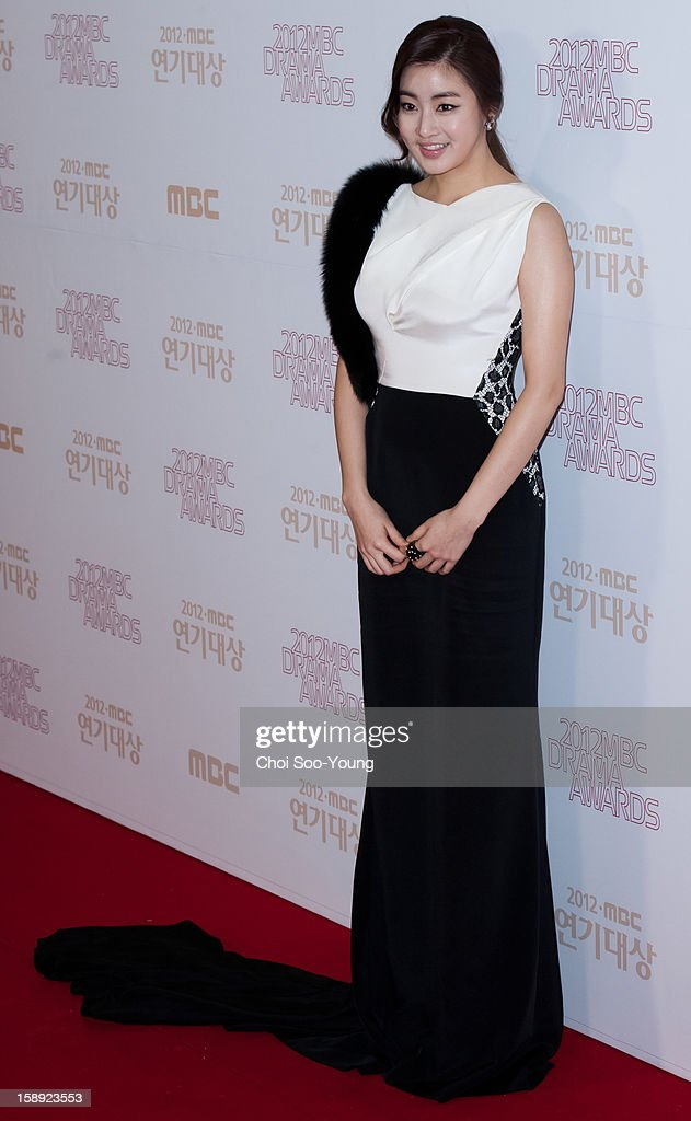 Kang So-Ra poses for photographs upon arrival during the 2012 MBC Drama Awards at MBC Open Hall on December 30, 2012 in Seoul, South Korea.