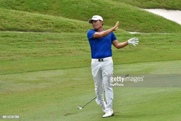 Kang Sunghoon of South Korea is droped his golf club from hand on 18th hall during the CIMB Classic 2017 day 4 on October 15 2017 at TPC Kuala Lumpur...