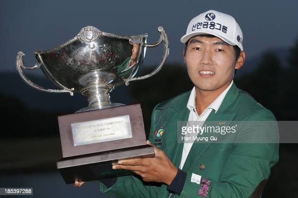 Kang SungHoon of South Korea lifts the winner's trophy during a ceremony following the final round of the 56th Kolon Korea Open 2013 at the Woo Jeong...