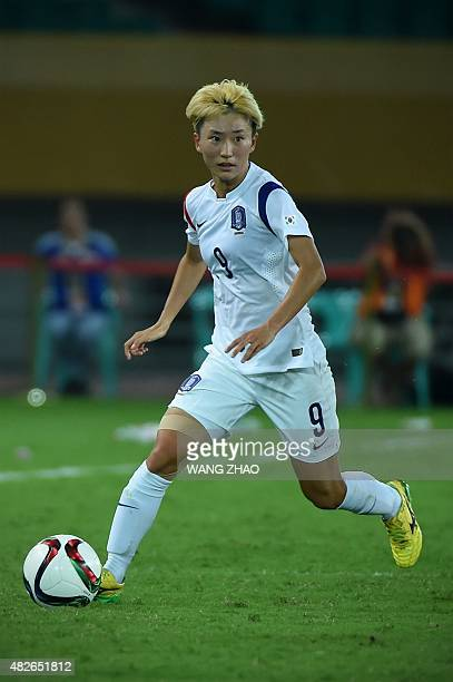 Kang Yumi of South Korea controls the ball during their women's East Asian Cup football match against China at the Wuhan Sports Center Stadium in...
