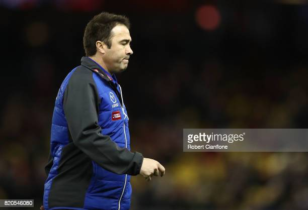 Kangaroos coach Brad Scott is seen at the break during the round 18 AFL match between the Essendon Bombers and the North Melbourne Kangaroos at...