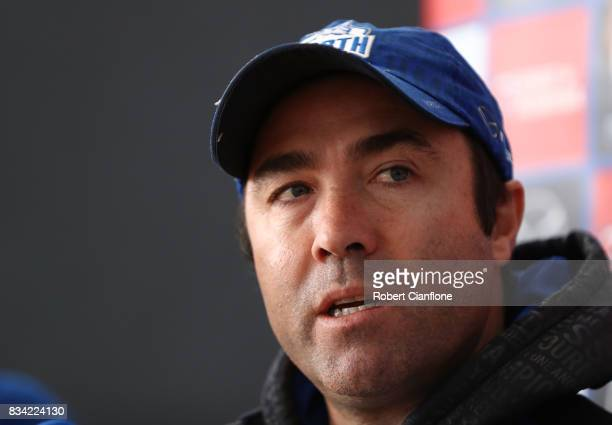 Kangaroos coach Brad Scott speaks to the media during a North Melbourne Kangaroos AFL training session at Arden Street Ground on August 18 2017 in...