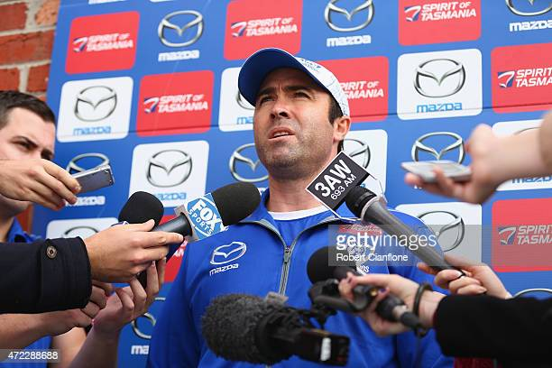 Kangaroos coach Brad Scott speaks to the media prior to a North Melbourne Kangaroos AFL training session at Arden Street Ground on May 6 2015 in...