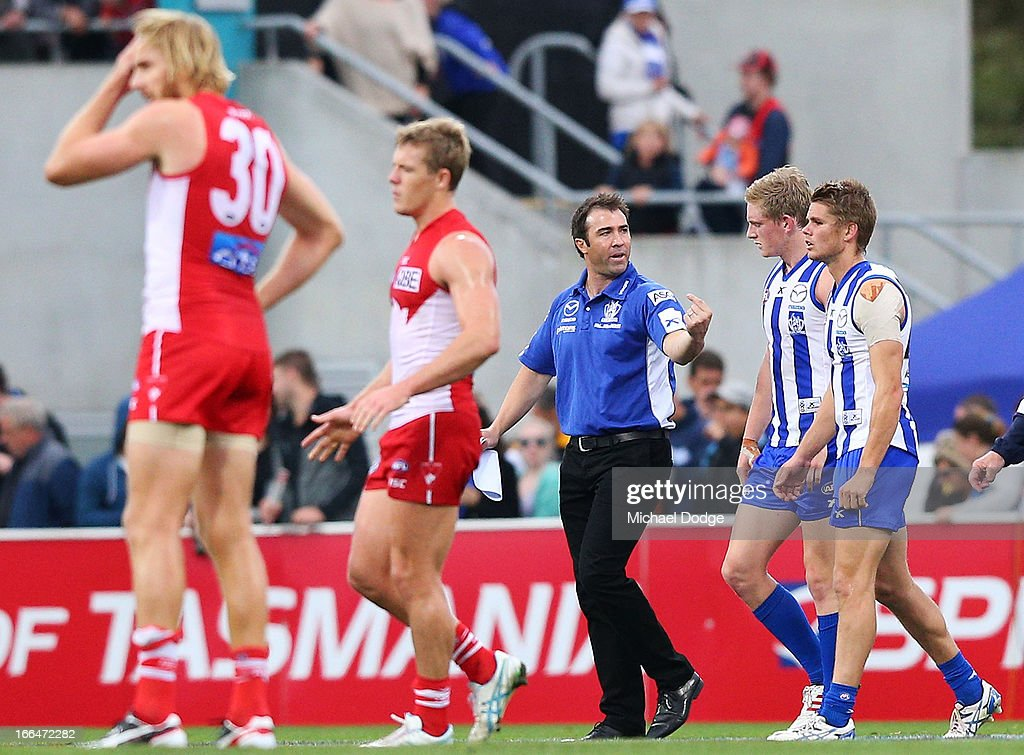 Kangaroos coach Brad Scott talks to Jack Ziebell and Taylor Hine (R) during the round three AFL match between the North Melbourne Kangaroos and the Sydney Swans at Blundstone Arena on April 13, 2013 in Hobart, Australia.