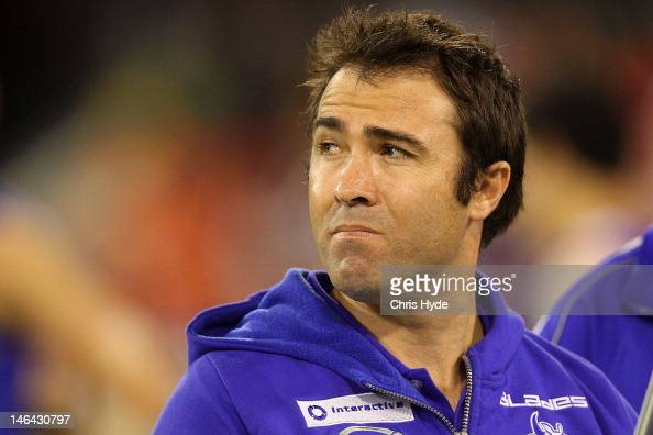 Kangaroos coach Brad Scott talks to the players at three quarter time during the round 12 AFL match between the Gold Coast Suns and the North...