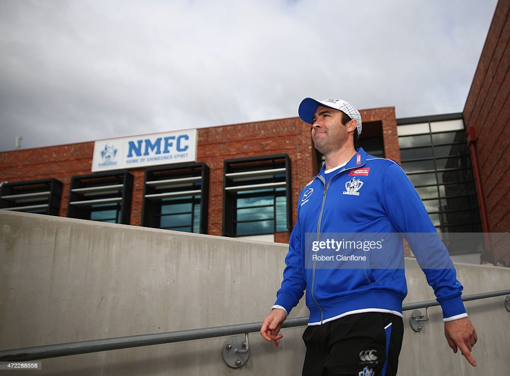 Kangaroos coach Brad Scott walks out for a North Melbourne Kangaroos AFL training session at Arden Street Ground on May 6 2015 in Melbourne Australia