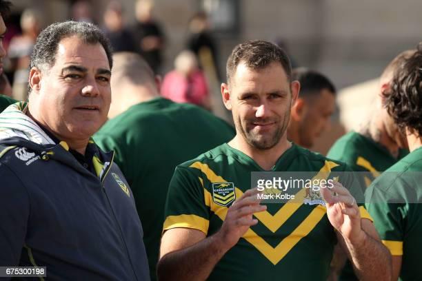 Kangaroos coach Mal Meniga and Kangaroos captain Cameron Smith speak after the team photo during an Australian Kangaroos media opportunity at the...