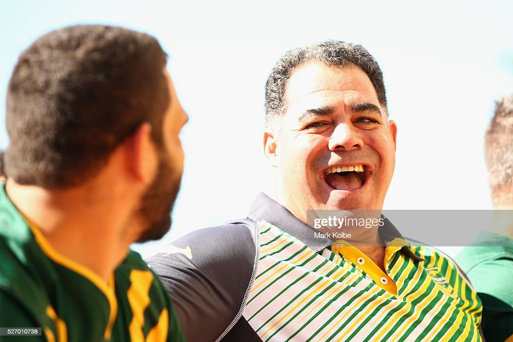 Kangaroos coach <a gi-track='captionPersonalityLinkClicked' href=/galleries/search?phrase=Mal+Meninga&family=editorial&specificpeople=553339 ng-click='$event.stopPropagation()'>Mal Meninga</a> shares a laugh with Greg Inglis during the Australia Kangaroos Test team photo session at Crowne Plaza Coogee on May 2, 2016 in Sydney, Australia.