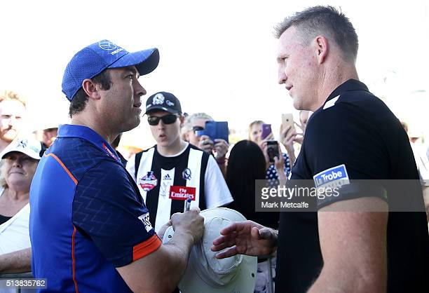 Kangaroos head coach Brad Scott and Magpies head coach Nathan Buckley talk before the 2016 AFL NAB Challenge match between the North Melbourne...
