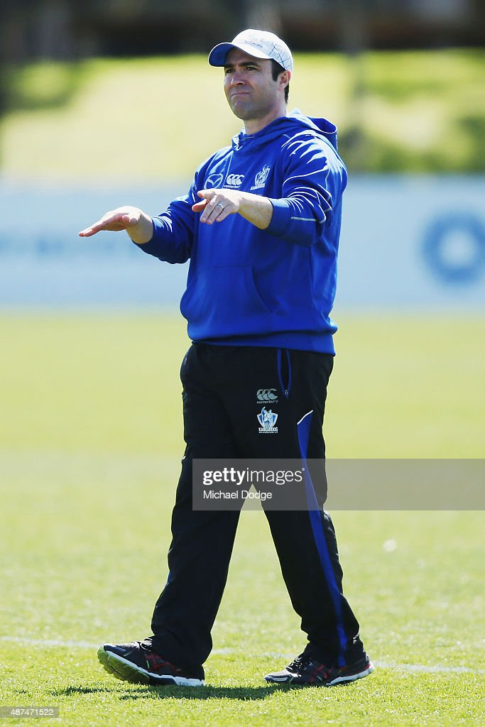 Kangaroos head coach Brad Scott gestures to his communications manager to stop media filming Daniel Wells doing his fitness test midway through a...