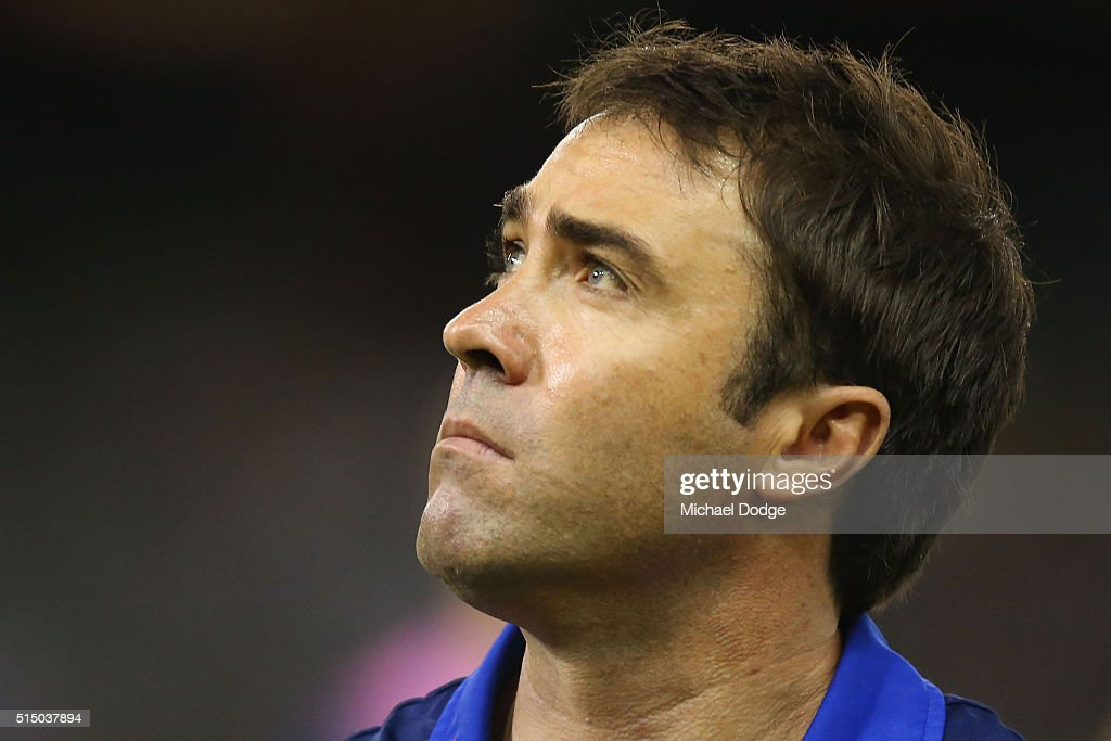 Kangaroos head coach Brad Scott looks at the scoreboard during the NAB CHallenge AFL match between the Hawthorn Hawks and the North Melbourne...