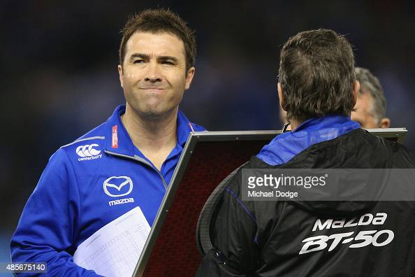 Kangaroos head coach Brad Scott ponders a selection move during the round 22 AFL match between the North Melbourne Kangaroos and the Western Bulldogs...