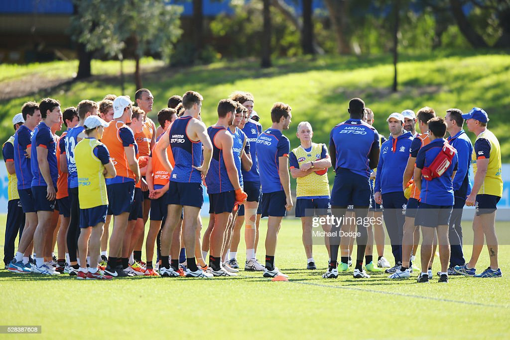Kangaroos head coach <a gi-track='captionPersonalityLinkClicked' href=/galleries/search?phrase=Brad+Scott+-+Australian+Rules+Football+Player&family=editorial&specificpeople=12237866 ng-click='$event.stopPropagation()'>Brad Scott</a> speaks to his players during a North Melbourne Kangaroos AFL media session at Arden Street Ground on May 5, 2016 in Melbourne, Australia.