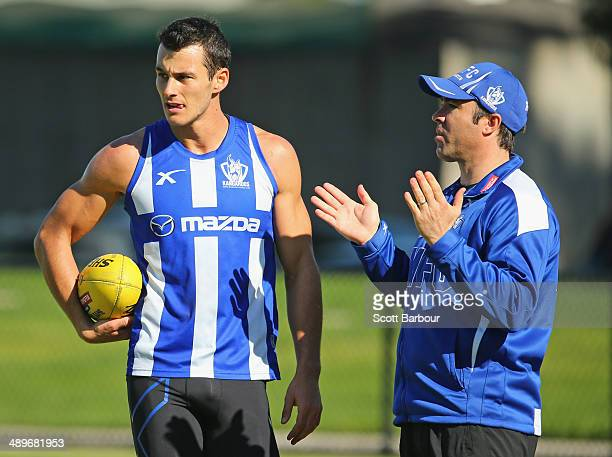 Kangaroos Head Coach Brad Scott speaks with Robbie Tarrant during a North Melbourne Kangaroos AFL training session at Arden Street Ground on May 12...