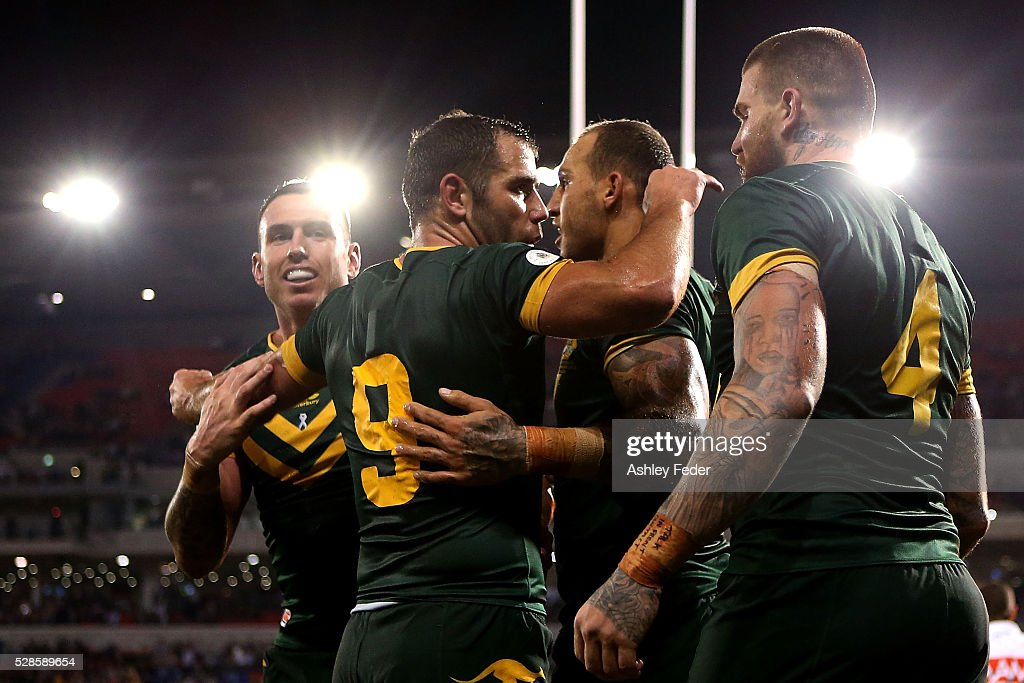 Kangaroos players celebrate a try during the International Rugby League Trans Tasman Test match between the Australian Kangaroos and the New Zealand Kiwis at Hunter Stadium on May 6, 2016 in Newcastle, Australia.