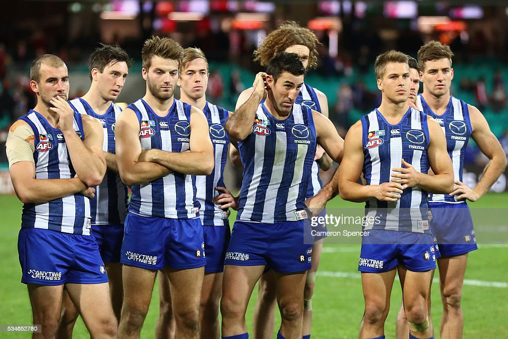 Kangaroos players look dejected after losing the round 10 AFL match between the Sydney Swans and the North Melbourne Kangaroos at Sydney Cricket Ground on May 27, 2016 in Sydney, Australia.