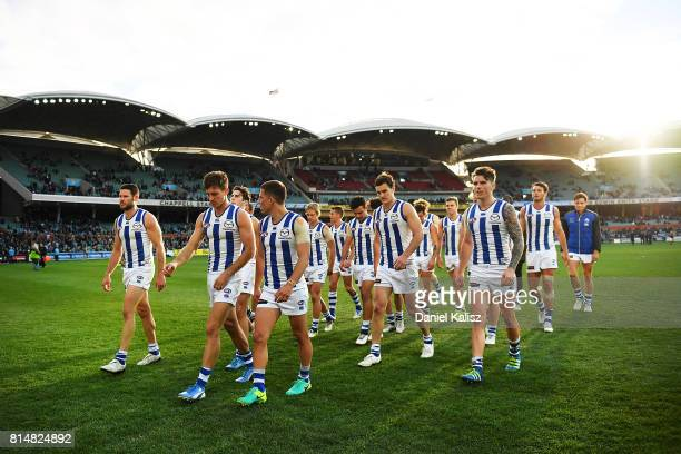 Kangaroos players walk from the ground after being defeated by the Power during the round 17 AFL match between the Port Adelaide Power and the North...